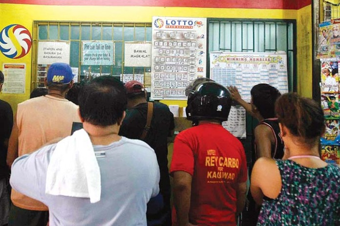 Lotto fans waiting for the results of the P700-million UltraLotto draw